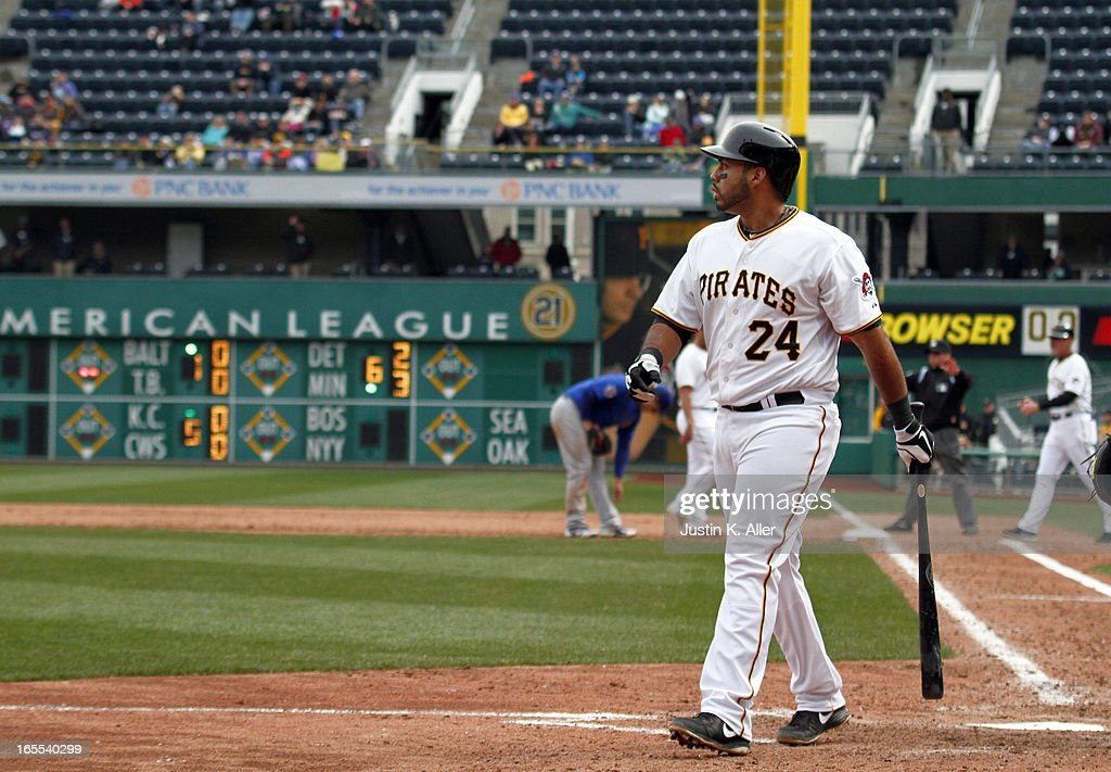 Pedro Alvarez #24 of the Pittsburgh Pirates walks off the field after striking out in the ninth inning against the Chicago Cubs during the game on April 4, 2013 at PNC Park in Pittsburgh, Pennsylvania. The Cubs defeated the Pirates 3-2.