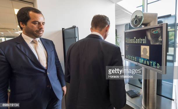 Pedro Alves VisionBox Business Development Director watches as European Commission VicePresident Jyrki Katainen in charge of Jobs Growth Investment...