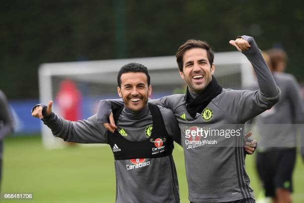 Pedro and Cesc Fabregas of Chelsea during a training session at Chelsea Training Ground on April 14 2017 in Cobham England