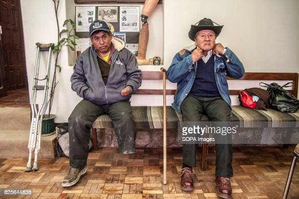 Pedro and Jose wait for their turn to take the measurements of what will be their new prosthesis Bolivian farmers walk again with the help of...