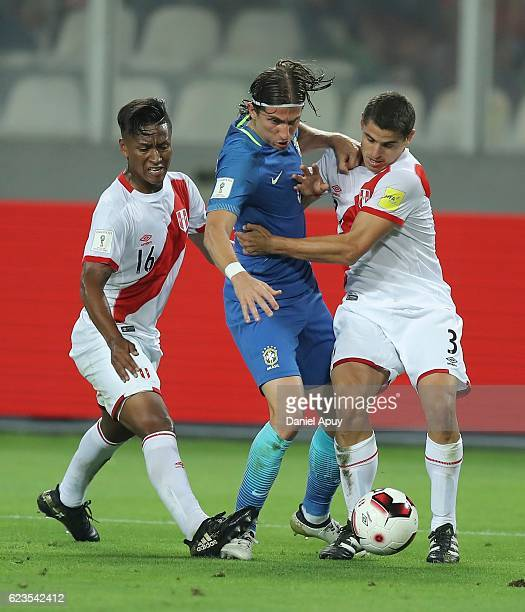 Pedro Aquino and Aldo Corzo of Peru defend against Filipe Luis of Brazil during a match between Peru and Brazil as part of FIFA 2018 World Cup...