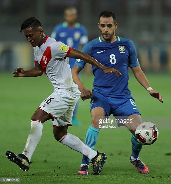 Pedro Aquino of Peru fights for the ball with Renato Augusto of Brazil during a match between Peru and Brazil as part of FIFA 2018 World Cup...