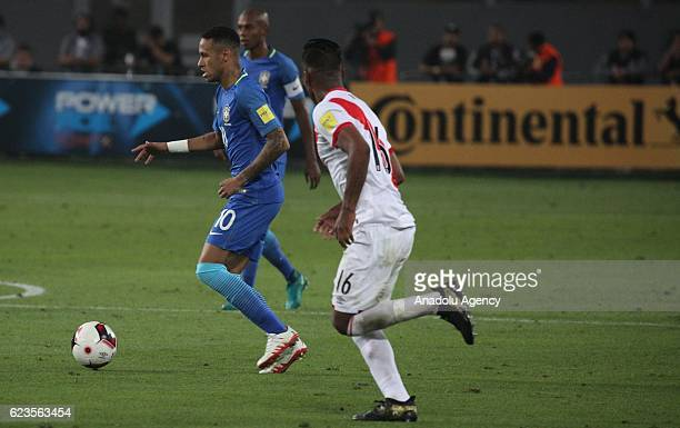 Pedro Aquino of Peru is in action against Neymar Jr of Brasil during 2018 World Cup Qualifying match between Peru and Brasil at National Stadium in...