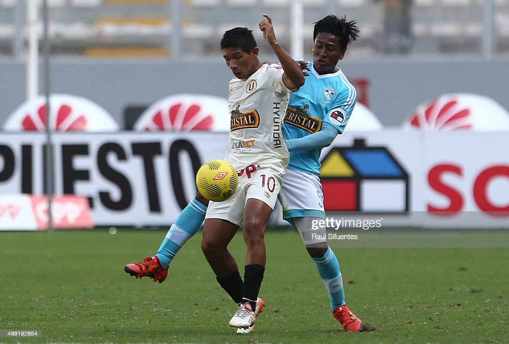 Pedro Aquino (R) of Sporting Cristal battles for the ball with <a gi-track='captionPersonalityLinkClicked' href=/galleries/search?phrase=Edison+Flores&family=editorial&specificpeople=8597891 ng-click='$event.stopPropagation()'>Edison Flores</a> (L) of Universitario during a match between Sporting Cristal and Universitario as part of 17th round of Torneo Clausura 2015 at Nacional Stadium on November 29, 2015 in Lima, Peru.
