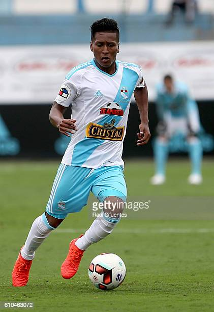 Pedro Aquino of Sporting Cristal drives the ball during a match between Sporting Cristal and Juan Aurich as part of Torneo Clausura 2016 at Alberto...