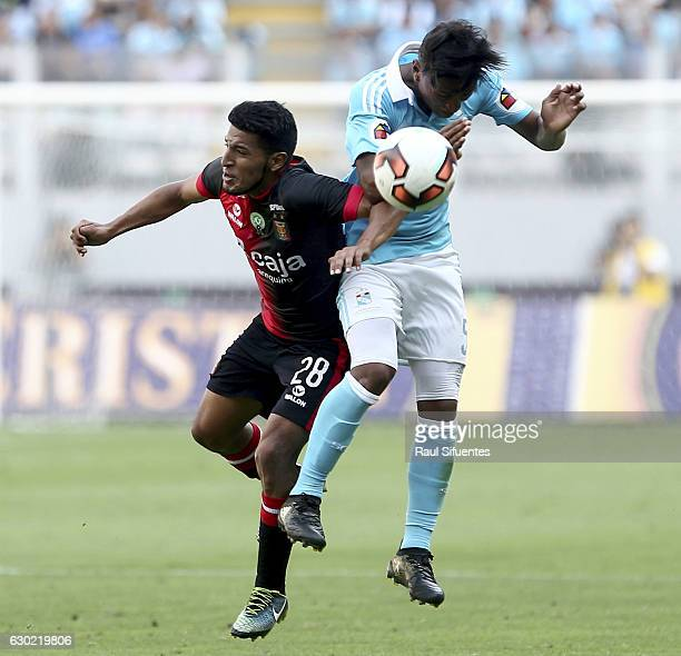 Pedro Aquino of Sporting Cristal struggles for the ball with Alexis Arias of FBC Melgar during a second leg final match between Sporting Cristal and...