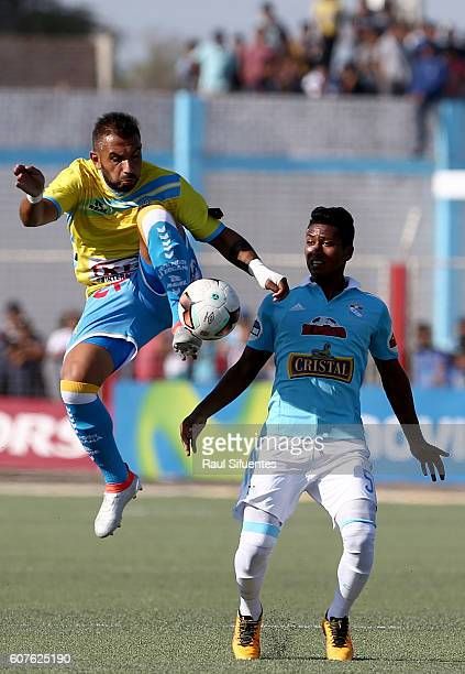 Pedro Aquino of Sporting Cristal struggles for the ball with Enzo Borges of Defensor La Bocana during a match between Defensor La Bocana and Sporting...