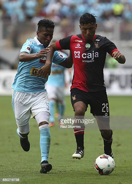 Pedro Aquino of Sporting Cristal struggles for the ball with Hernan Hinostroza of FBC Melgar during a second leg final match between Sporting Cristal...