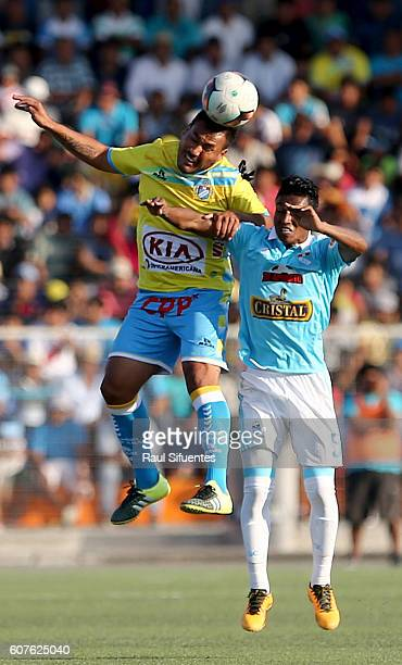 Pedro Aquino of Sporting Cristal struggles for the ball with Roberto Jimenez of Defensor La Bocana during a match between Defensor La Bocana and...