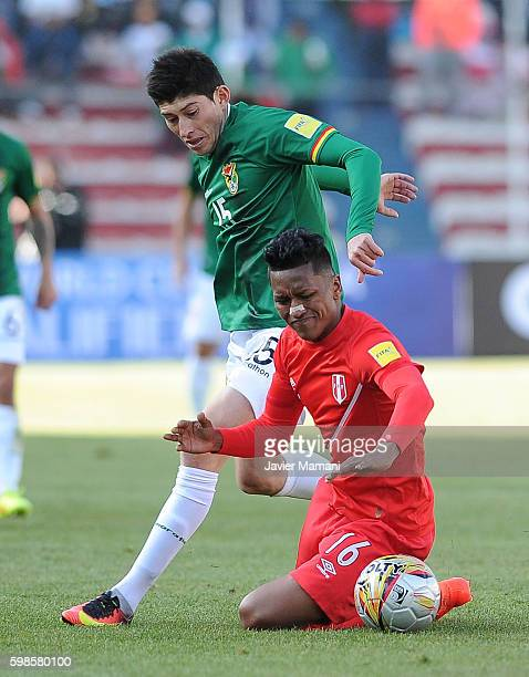 Pedro Azogue of Bolivia fights for the ball with Pedro Aquino of Peru during a match between Bolivia and Peru as part of FIFA 2018 World Cup...