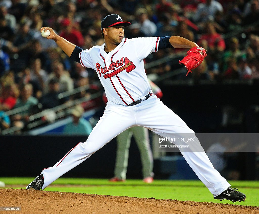 Pedro Beato of the Atlanta Braves throws pitch in the eighth inning against the Philadelphia Phillies at Turner Field on June 17 2014 in Atlanta...