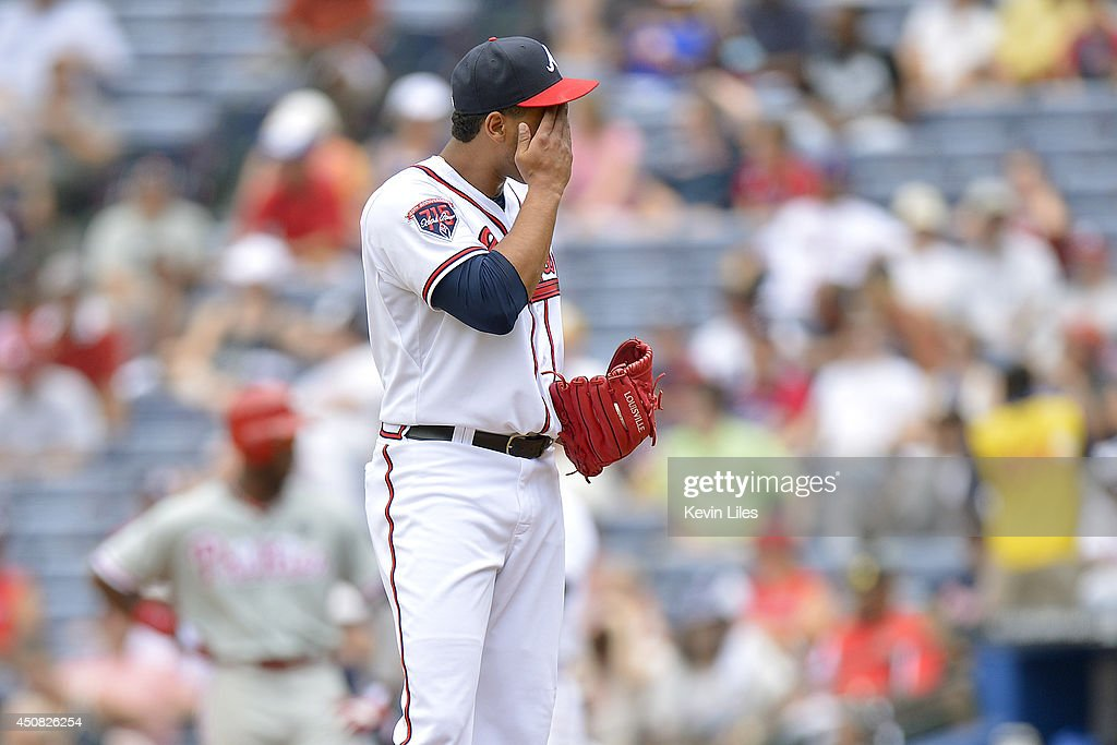Pedro Beato of the Atlanta Braves wipes his face against the Philadelphia Phillies during the fifth inning at Turner Field on June 18 2014 in Atlanta...
