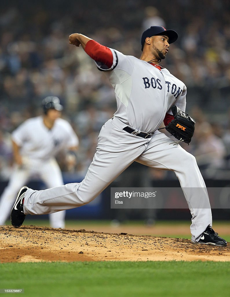 Pedro Beato of the Boston Red Sox delivers a pitch against the New York Yankees on October 3 2012 at Yankee Stadium in the Bronx borough of New York...