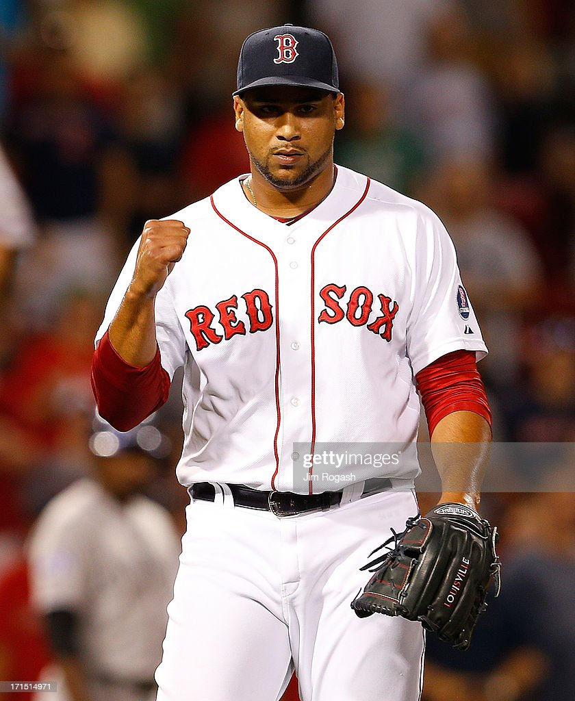 Pedro Beato of the Boston Red Sox reacts after Red Sox defeated the the Colorado Rockiese 114 at Fenway Park on June 25 2013 in Boston Massachusetts