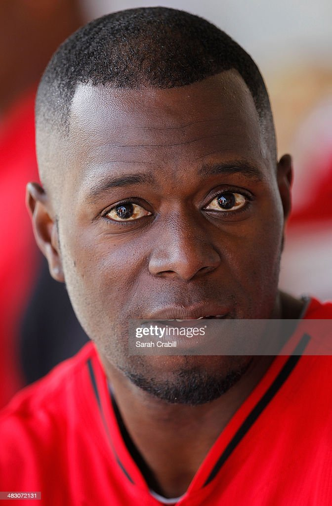Pedro Beato of the Cincinnati Reds looks on in the dugout during a game against the Milwaukee Brewers at Maryvale Baseball Park on March 27 2014 in...
