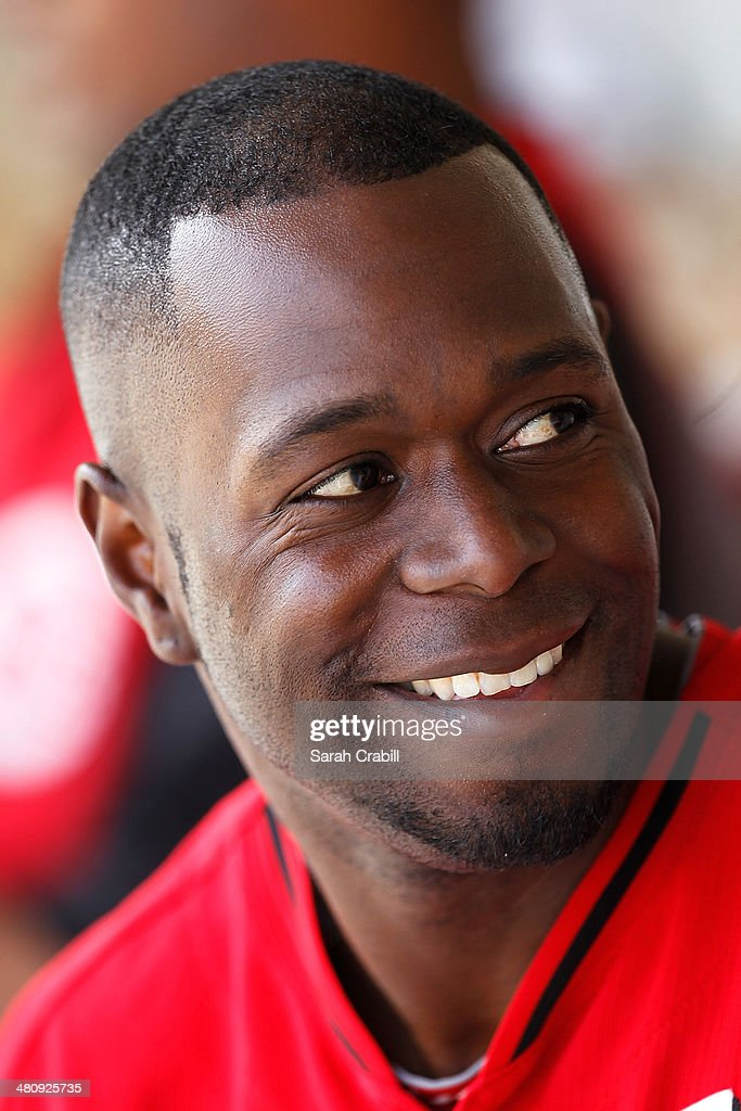 Pedro Beato of the Cincinnati Reds smiles in the dugout during a game against the Milwaukee Brewers at Maryvale Baseball Park on March 27 2014 in...