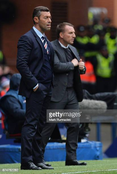Pedro Caixinha manager of Rangers looks on with Brendan Rodgers manager of Celtic during the Ladbrokes Scottish Premiership match between Rangers and...