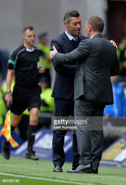 Pedro Caixinha of Rangers and Brendan Rodgers of Celtic shake hands at the final whistle during the Ladbrokes Scottish Premiership match between...