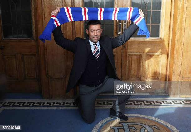 Pedro Caixinha poses at the front entrance to Ibrox after he is unveiled as the new manager of Rangers at Ibrox Stadium on March 13 2017 in Glasgow...