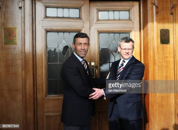 Pedro Caixinha poses with Rangers Managing Director Stewart Robertson after he is unveiled as the new manager of Rangers at Ibrox Stadium on March 13...