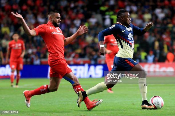 Pedro Canelo of Toluca and Alex Ibarra of America fight for the ball during the 12th round match between Toluca and America as part of the Torneo...