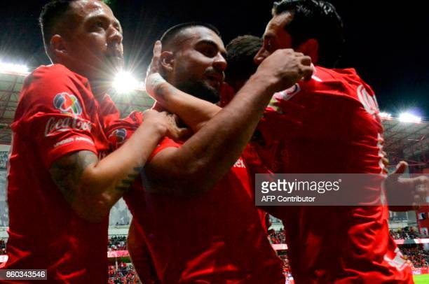 Pedro Canelo of Toluca celebrates his goal against Lobos Buap during their Mexican Apertura tournament football match at the Nemesio Diez stadium in...