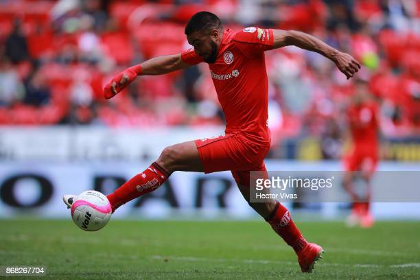 Pedro Canelo of Toluca drives the ball during the 15th round match between Toluca and Morelia as part of the Torneo Apertura 2017 Liga MX at Nemesio...