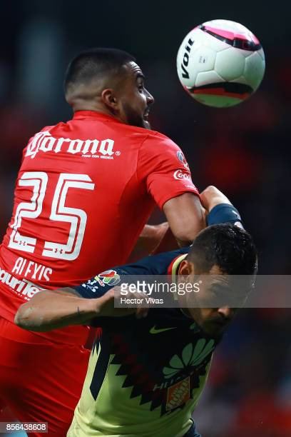 Pedro Canelo of Toluca goes for a header with Miguel Angel Samudio of America during the 12th round match between Toluca and America as part of the...