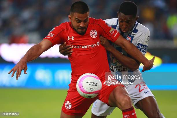 Pedro Canelo of Toluca struggles for the ball against Oscar Murillo of Pachuca during the 10th round match between Pachuca and Toluca as part of the...