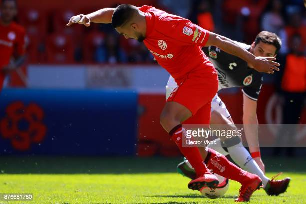 Pedro Canelo of Toluca struggles for the ball with Alejandro Donatti of Tijuana during the 17th round match between Toluca and Tijuana as part of the...