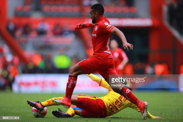Pedro Canelo of Toluca struggles for the ball with Carlos Guzman of Morelia during the 15th round match between Toluca and Morelia as part of the...