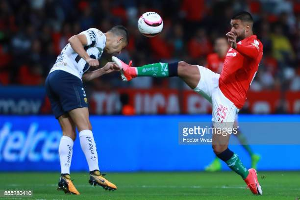 Pedro Canelo of Toluca struggles for the ball with Gerardo Alcoba of Pumas during the 11th round match between Toluca and Pumas UNAM as part of the...