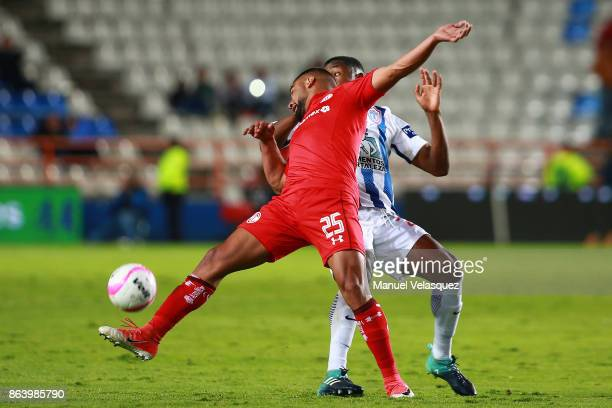 Pedro Canelo of Toluca struggles for the ball with Oscar Murillo of Pachuca during the 10th round match between Pachuca and Toluca as part of the...
