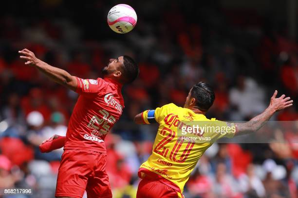 Pedro Canelo of Toluca struggles for the ball with Rodrigo Millar of Morelia during the 15th round match between Toluca and Morelia as part of the...
