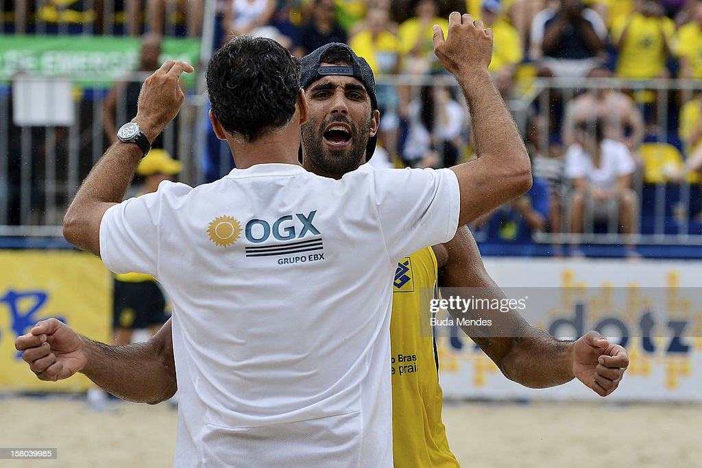 Pedro (yellow) celebrates a victory and the title during a beach volleyball match against the 6th stage of the season 2012/2013 Circuit Bank of Brazil at Copacabana Beach on December 09, 2012 in Rio de Janeiro, Brazil.