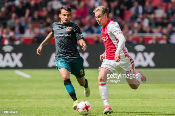 Pedro Chirivella Burgos of Go Ahead Eagles Frenkie de Jong of Ajaxduring the Dutch Eredivisie match between Ajax Amsterdam and Go Ahead Eagles at the...