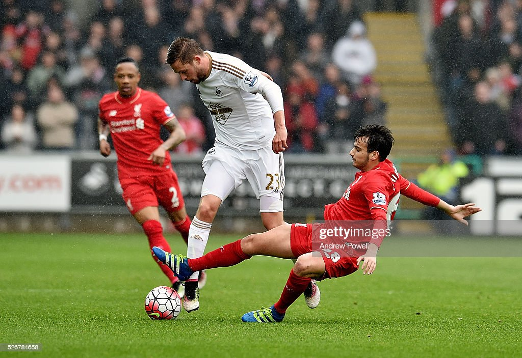 <a gi-track='captionPersonalityLinkClicked' href=/galleries/search?phrase=Pedro+Chirivella&family=editorial&specificpeople=11754615 ng-click='$event.stopPropagation()'>Pedro Chirivella</a> of Liverpool goes in on Golfi Sigurosson of Swansea City during a Premier League match between Swansea City and Liverpool at the Liberty Stadium on May 01, 2016 in Swansea, Wales.