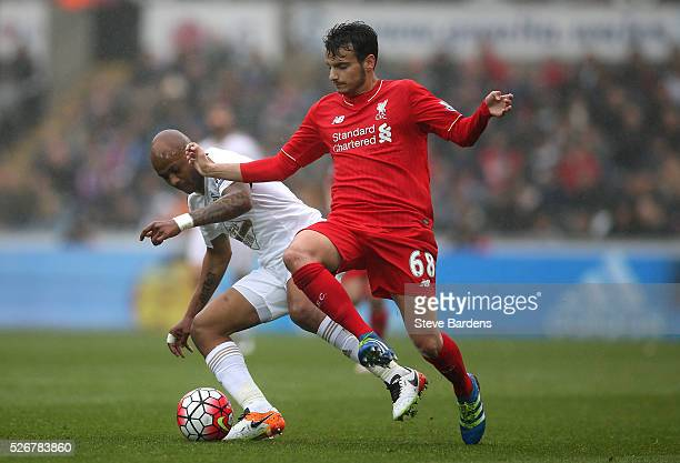 Pedro Chirivella of Liverpool is closed down by Andre Ayew of Swansea City during the Barclays Premier League match between Swansea City and...