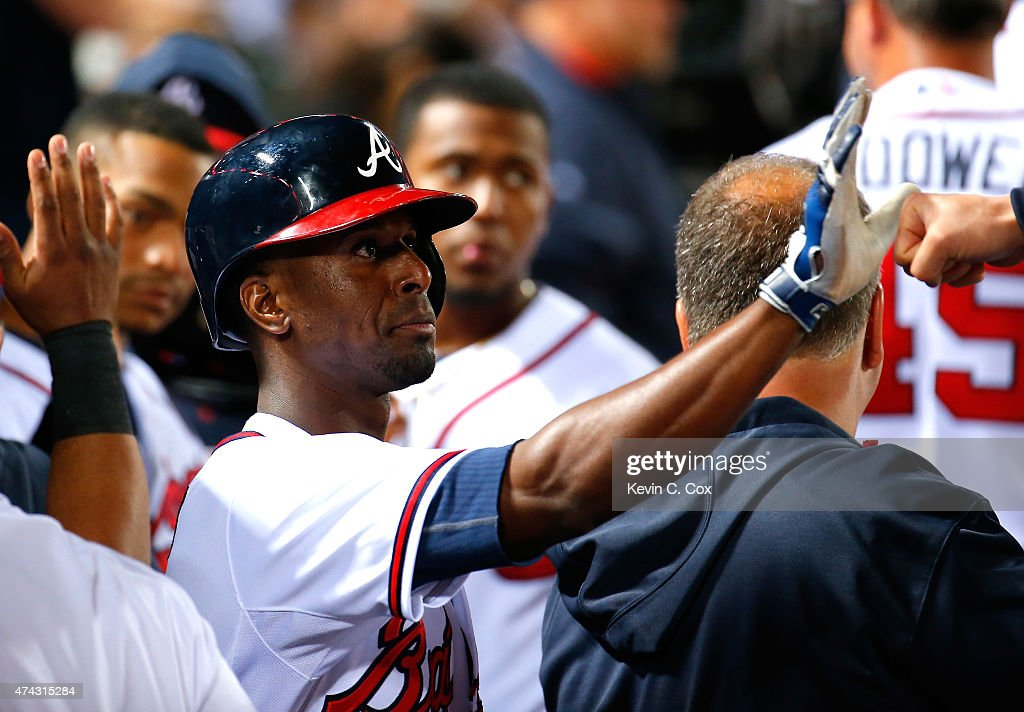 <a gi-track='captionPersonalityLinkClicked' href=/galleries/search?phrase=Pedro+Ciriaco&family=editorial&specificpeople=5718591 ng-click='$event.stopPropagation()'>Pedro Ciriaco</a> #13 of the Atlanta Braves reacts after scoring on a 2-RBI single hit by Cameron Maybin #25 in the seventh inning against the Milwaukee Brewers at Turner Field on May 21, 2015 in Atlanta, Georgia.