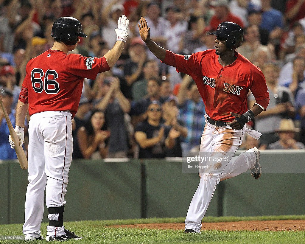 Pedro Ciriaco #77 of the Boston Red Sox celebrates with <a gi-track='captionPersonalityLinkClicked' href=/galleries/search?phrase=Daniel+Nava&family=editorial&specificpeople=670454 ng-click='$event.stopPropagation()'>Daniel Nava</a> #66 of the Boston Red Sox after scoring a run in the seventh inning against the New York Yankees during the second game of a doubleheader at Fenway Park July 7, 2012 in Boston, Massachusetts.