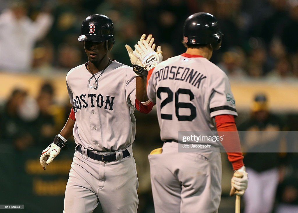 <a gi-track='captionPersonalityLinkClicked' href=/galleries/search?phrase=Pedro+Ciriaco&family=editorial&specificpeople=5718591 ng-click='$event.stopPropagation()'>Pedro Ciriaco</a> #77 of the Boston Red Sox celebrtes with <a gi-track='captionPersonalityLinkClicked' href=/galleries/search?phrase=Scott+Podsednik&family=editorial&specificpeople=209416 ng-click='$event.stopPropagation()'>Scott Podsednik</a> #26 after scoring against the Oakland Athletics during a Major League Baseball game at the O.co Coliseum on September 1, 2012 in Oakland, California.
