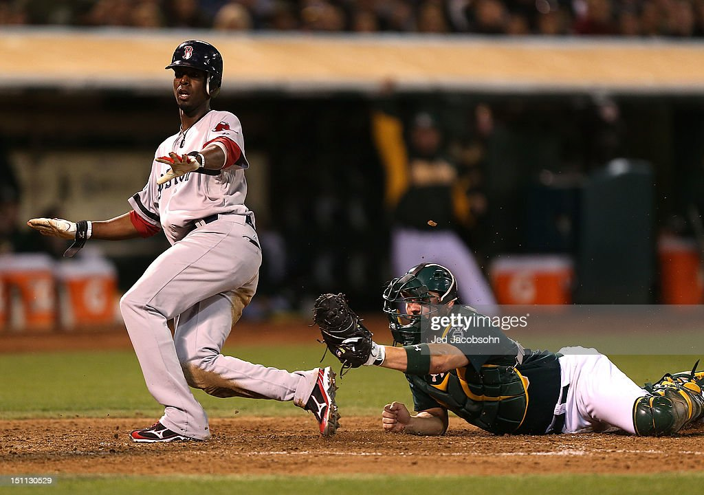 <a gi-track='captionPersonalityLinkClicked' href=/galleries/search?phrase=Pedro+Ciriaco&family=editorial&specificpeople=5718591 ng-click='$event.stopPropagation()'>Pedro Ciriaco</a> #77 of the Boston Red Sox slides home safe as <a gi-track='captionPersonalityLinkClicked' href=/galleries/search?phrase=Derek+Norris&family=editorial&specificpeople=6795804 ng-click='$event.stopPropagation()'>Derek Norris</a> #36 of the Oakland Athletics applies the tag during a Major League Baseball game at the O.co Coliseum on September 1, 2012 in Oakland, California.