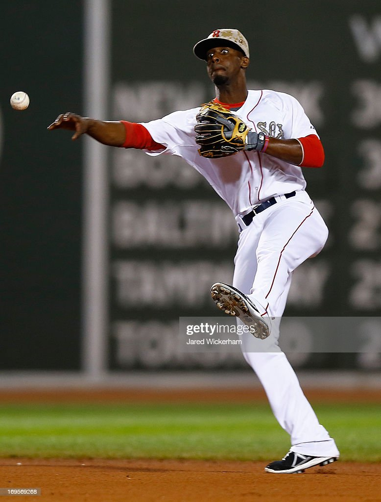 <a gi-track='captionPersonalityLinkClicked' href=/galleries/search?phrase=Pedro+Ciriaco&family=editorial&specificpeople=5718591 ng-click='$event.stopPropagation()'>Pedro Ciriaco</a> #23 of the Boston Red Sox throws to first base against the Philadelphia Phillies during the interleague game on May 27, 2013 at Fenway Park in Boston, Massachusetts.