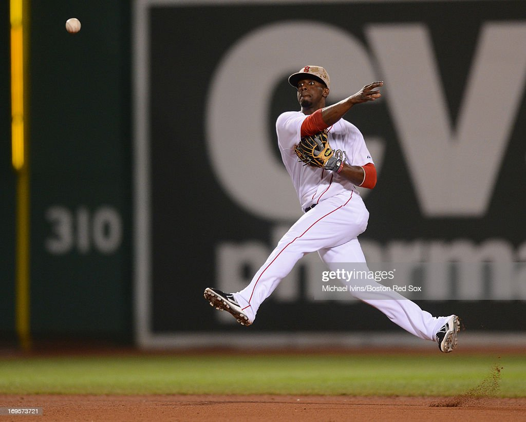 <a gi-track='captionPersonalityLinkClicked' href=/galleries/search?phrase=Pedro+Ciriaco&family=editorial&specificpeople=5718591 ng-click='$event.stopPropagation()'>Pedro Ciriaco</a> #23 of the Boston Red Sox throws to first base against the Philadelphia Phillies in the eighth inning on May 27, 2013 at Fenway Park in Boston, Massachusetts.