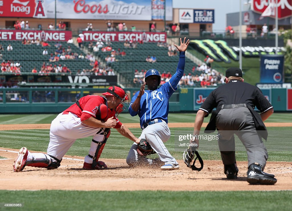 Pedro Ciriaco #37 of the Kansas City Royals slides safely past the tag of catcher Chris Iannetta #17 of the Los Angeles Angels of Anaheim and scores a run in the third inning at Angel Stadium of Anaheim on May 25, 2014 in Anaheim, California.