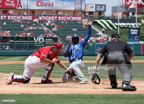 Pedro Ciriaco of the Kansas City Royals slides safely past the tag of catcher Chris Iannetta of the Los Angeles Angels of Anaheim and scores a run in...