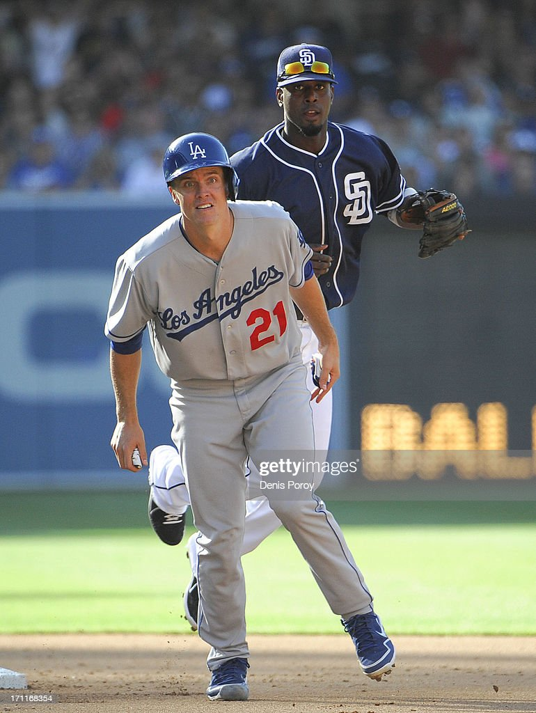 <a gi-track='captionPersonalityLinkClicked' href=/galleries/search?phrase=Pedro+Ciriaco&family=editorial&specificpeople=5718591 ng-click='$event.stopPropagation()'>Pedro Ciriaco</a> #3 of the San Diego Padres and <a gi-track='captionPersonalityLinkClicked' href=/galleries/search?phrase=Zack+Greinke&family=editorial&specificpeople=212804 ng-click='$event.stopPropagation()'>Zack Greinke</a> #21 of the Los Angeles Dodgers watch the throw to first as he tries to turn a double play during the fifth inning of a baseball game at Petco Park on June 22, 2013 in San Diego, California. Skip Schumaker #3 of the Los Angeles Dodgers was safe at first and a run scored on the play.