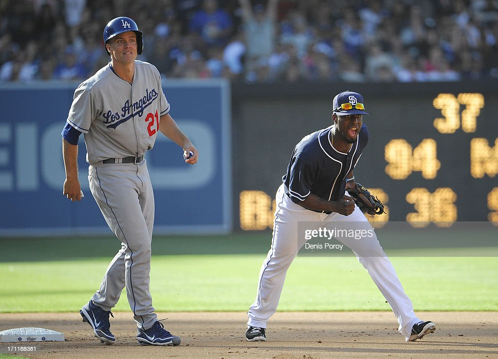<a gi-track='captionPersonalityLinkClicked' href=/galleries/search?phrase=Pedro+Ciriaco&family=editorial&specificpeople=5718591 ng-click='$event.stopPropagation()'>Pedro Ciriaco</a> #3 of the San Diego Padres celebrates after he thinks he's turned a double play as <a gi-track='captionPersonalityLinkClicked' href=/galleries/search?phrase=Zack+Greinke&family=editorial&specificpeople=212804 ng-click='$event.stopPropagation()'>Zack Greinke</a> #21 of the Los Angeles Dodgers looks on during the fifth inning of a baseball game at Petco Park on June 22, 2013 in San Diego, California. Skip Schumaker #3 of the Los Angeles Dodgers was safe at first and a run scored on the play.