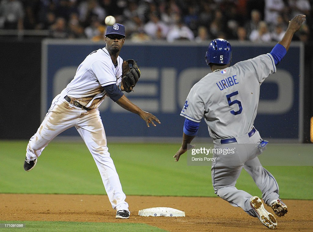<a gi-track='captionPersonalityLinkClicked' href=/galleries/search?phrase=Pedro+Ciriaco&family=editorial&specificpeople=5718591 ng-click='$event.stopPropagation()'>Pedro Ciriaco</a> #3 of the San Diego Padres throws over <a gi-track='captionPersonalityLinkClicked' href=/galleries/search?phrase=Juan+Uribe&family=editorial&specificpeople=209187 ng-click='$event.stopPropagation()'>Juan Uribe</a> #5 of the Los Angeles Dodgers as he turns a double play to end the sixth inning of a baseball game at Petco Park on June 21, 2013 in San Diego, California.