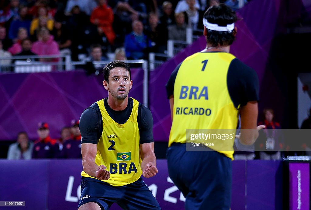 Pedro Cunha and Ricardo Santos of Brazil react against Jonas Reckermann and Julius Brink of Germany during the Men's Beach Volleyball quarterfinal match between Germany and Brazil on Day 10 of the London 2012 Olympic Games at Horse Guards Parade August 6, 2012 in London, England.